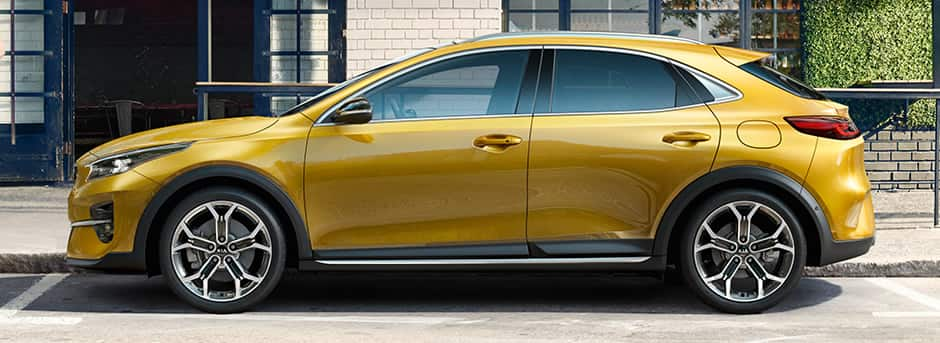 yellow kia xceed side view